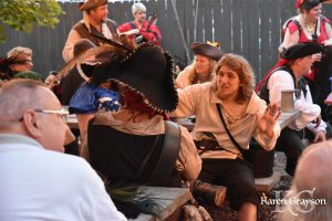 Animated conversations at the PiratePalooza pub sing